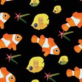 Clown fish and starfish chaetodon seamless pattern