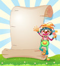 A clown with flowers beside the blank paper illustration of Stock Photos
