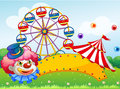 A clown in front of a ferris wheel illustration Stock Photo