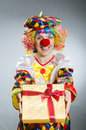 Clown with giftbox in funny concept the Royalty Free Stock Photo