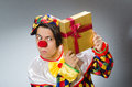 Clown with giftbox in funny concept the Royalty Free Stock Photography