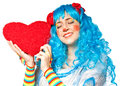 Clown girl holding heart Stock Photo