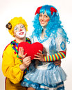 Clown giving his heart actress. Royalty Free Stock Photos