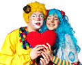 Clown giving his heart actress. Stock Image
