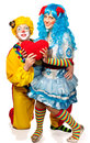 Clown giving his heart actress. Royalty Free Stock Photo