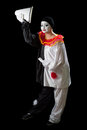 Clown greetings mime pierrot isolated on black greeting with her hat Royalty Free Stock Images
