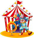 A clown holding balloons near the ring of fire illustration on white background Royalty Free Stock Photography