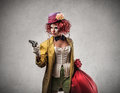 Clown holding a gun scary and bag full of money Royalty Free Stock Photography