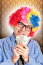 Clown with money Stock Image