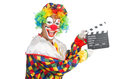 Clown with movie board on white Royalty Free Stock Images