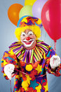 Clown Offering Balloon Stock Images