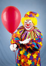 Clown Offers Balloon Stock Photos