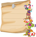 Clown and paper illustration of clowns in front of Royalty Free Stock Photography