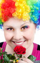 Clown with rainbow make up with rose Royalty Free Stock Photos