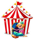 A clown sitting in front of a red circus tent illustration on white background Stock Images