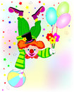 Clown standing upside down with flowers in hand Royalty Free Stock Photography