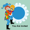 Clown with symbols colorful jester and placard behine Stock Photo