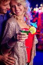 Club couple vertical image of a cheerful beauty hanging out in the with her boyfriend Stock Image