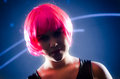 Club girl with pink hair hot bright in front of an led screen Stock Photo