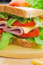 Club Sandwich with Cheese, Pickled Cucumber, Tomato and ham. Gar Royalty Free Stock Photo