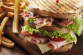 Club sandwich close up of fresh with ham bacon tomatoes cheese and lettuce Royalty Free Stock Photography