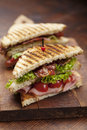 Club sandwich close up of fresh with ham bacon tomatoes cheese and lettuce Stock Photos
