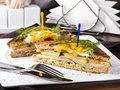Club sandwich with egg, cucumber, tomato, ham Royalty Free Stock Photo