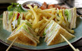 Club sandwich with fries ham and cheese and vegetable Stock Photography