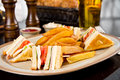 Club sandwich with fries at the restaurant Royalty Free Stock Photos
