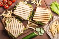Club sandwich with tomatoes , cucumber , ham and cheese Royalty Free Stock Photo
