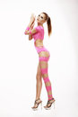 Clubbing red head woman in pink stagy costume redhead Royalty Free Stock Image
