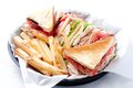 Clubhouse sandwich with crispy fries Royalty Free Stock Photo