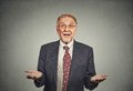 Clueless senior man, arms out asking why what's problem Royalty Free Stock Photo