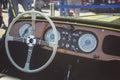 Cluj-Napoca, Romania - 24 September 2016 Klausenburg Retro Racing - Morgan Classic Retro Car steering wheel and wooden board detai