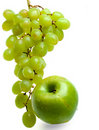 Cluster of grapes in water drops and apple Stock Image