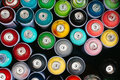 Cluster of spray paint cans, from abve