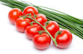 Cluster tomatoes with chive isolated on white Royalty Free Stock Images