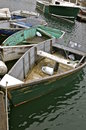 Cluster of wood rowboats a group are tied to a dock Royalty Free Stock Images