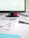 Cluttered desk with business documents Royalty Free Stock Photo