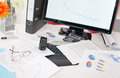 Cluttered desk with business documents Royalty Free Stock Image