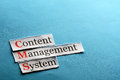 Cms abbreviation content management system on blue paper Royalty Free Stock Image