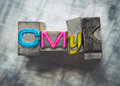 Cmyk letters with vintage grunge letterpress type Stock Photography