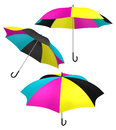 Cmyk umbrella color protection c processing ink colored umbrellas with different view angles as metaphor for protect from light or Royalty Free Stock Photos