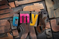 Cmyk written with antique letterpress type colored vintage printing blocks on random letters background Stock Image