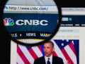 Cnbc photo of homepage on a monitor screen through a magnifying glass Royalty Free Stock Photos