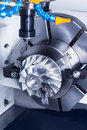 Cnc milling machine parts during manufacture of detail the impeller Royalty Free Stock Photos