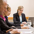 Co-workers meeting at table in conference room Royalty Free Stock Photo