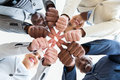 Co workers thumbs joined together low angle view of multiracial with Royalty Free Stock Images