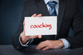 Coach advertisement concept man show card with text coaching Royalty Free Stock Images