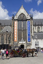 Coach in amsterdam holland august with hourses for trips with tourists front of the new church on dam square on august Stock Photography